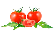 Lush tomatos. With green leafs. Isolated over white Royalty Free Stock Image