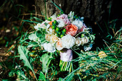 Lush wedding bouquet. Under the tree Royalty Free Stock Photography