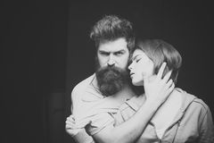 Lust. Fashion shot of couple after haircut. Hairstyle concept. Man with stylish beard and mustache and girl with fresh stock photography