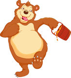 Lustige Bärnkarikatur mit Honig Stockfotos