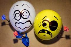 Lustige Ballongesichter werden erschrocken Stockbild