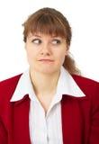 Lustige Blicke der jungen Frau im links Lizenzfreie Stockfotos