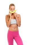 Lustige Frau, die mit Banane spielt Lizenzfreie Stockfotos