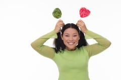 Lustige Frau mit Süßigkeit Stockfoto