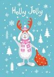 Lustige Grußkarte der Winterweihnachtsweihnachtsstechpalme mit der netten Karikatur, die Kaninchen mit Geschenksack auf blauer Be Stockfotografie