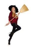 Lustige Hexe mit dem Besen lokalisiert Stockfoto