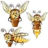 Lustige Honigbienen mit einer Wanne Honig Lizenzfreie Stockbilder