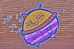 Lustige humorvolle Graffiti auf einer städtischen Wand stockbilder