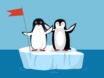 Lustige Kaiser-Pinguine auf arktischem Gletscher mit Flagge Stockfotografie