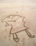 Lustige Malerei im Sand Lizenzfreie Stockfotos