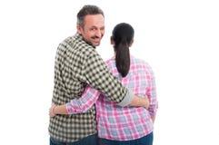 Lustige Paare mit dem männlichen Blinzeln Lizenzfreie Stockfotografie