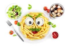 Lustige Pommes-Fritesmahlzeit Stockfotos