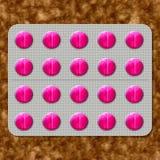 Lustige rosa Pillen Stockfotografie