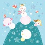 Lustige Schneemänner Stockbild