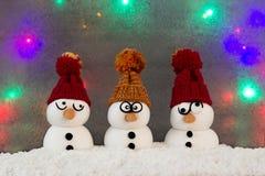Lustige Schneemänner Stockfotos