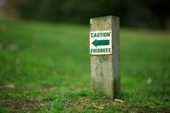 Lustige Zeichen AchtungFrisbees Lizenzfreies Stockbild