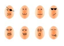 Lustige Zeichnungs-Gesichter auf Eiisolat auf Weiß mit Klipp Stockbilder