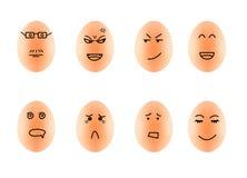 Lustige Zeichnungs-Gesichter auf Eiisolat auf Weiß mit Klipp Stockfotografie