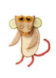 Lustiger Affe gemacht vom Brot, vom Käse und vom Gemüse Stockbilder