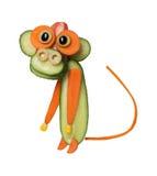 Lustiger Affe gemacht von der Gurke und von der Karotte Stockbilder