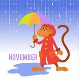 Lustiger Affe mit einem Regenschirm im Regen Stockfotografie