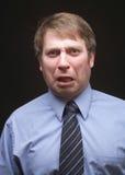 lustiger Ausdruck des Geschäftsmannes Stockfoto