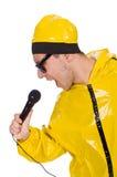 Lustiger Ausführender mit mic lokalisiert Lizenzfreie Stockbilder
