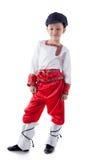 Lustiger blonder Junge, der im rustikalen Kostüm aufwirft Stockbilder