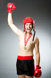 Lustiger Boxer mit dem Gewinnen Lizenzfreie Stockfotos
