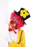 Lustiger Clown, der eine Fahne anhält Lizenzfreie Stockfotos
