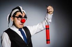 Lustiger Clown mit Stöcken Stockfotografie