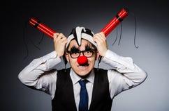 Lustiger Clown mit Stöcken Lizenzfreie Stockfotografie