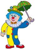 Lustiger Clownholdingregenschirm Stockfoto