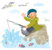 Lustiger Fischer auf einem Felsen Stockfotografie