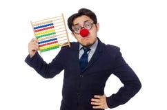 Lustiger Geschäftsmann mit dem Abakus lokalisiert auf Weiß Lizenzfreies Stockfoto