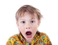 Lustiger Gesicht verziehendes Junge Lizenzfreies Stockbild