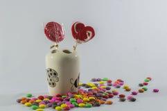 Lustiger glücklicher weißer Hintergrund der Süßigkeit Stockfoto