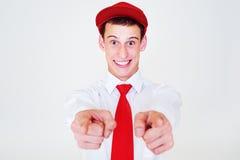 Lustiger glücklicher Mann in der roten Schutzkappe Stockfotos
