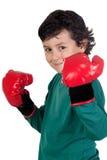 Lustiger Junge mit Verpackenhandschuhen Stockfoto