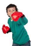 Lustiger Junge mit Verpackenhandschuhen Stockfotografie
