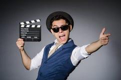 Lustiger Mann mit Film lizenzfreie stockfotos