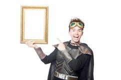Lustiger Pilot mit dem Bilderrahmen lokalisiert Lizenzfreies Stockfoto