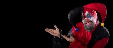 Lustiger Spaßvogel, der zum copyspace, zum Konzept Halloween und zum Horror darstellt Lizenzfreies Stockfoto