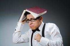 Lustiger Student mit Büchern Lizenzfreie Stockfotografie