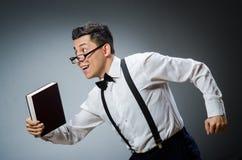 Lustiger Student mit Büchern Stockfoto
