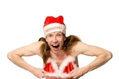 Lustiger Weihnachtsmann, der stri tut Stockbild