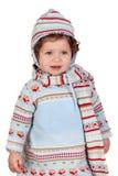 Lustiges Baby mit Winterkleidung Stockfotografie