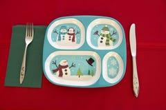 Lustiges Feiertags-Kinderweihnachtstabellen-Gedeck Stockbilder