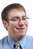 Lustiges Gesicht des Geschäftsmannes Stockfotografie