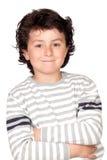 Lustiges Kind mit gestreifter Strickjacke Stockfotos